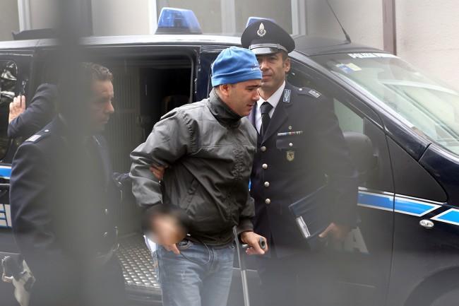 Giuseppe Farina all'arrivo in tribunale